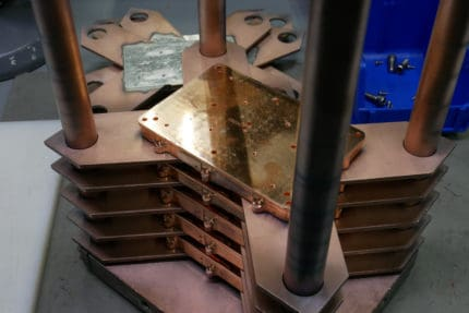 copper parts fixtured for electron beam welding
